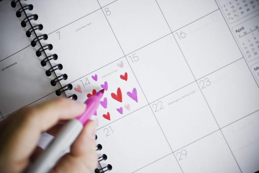 Woman Marking Valentine's Day on a Calendar