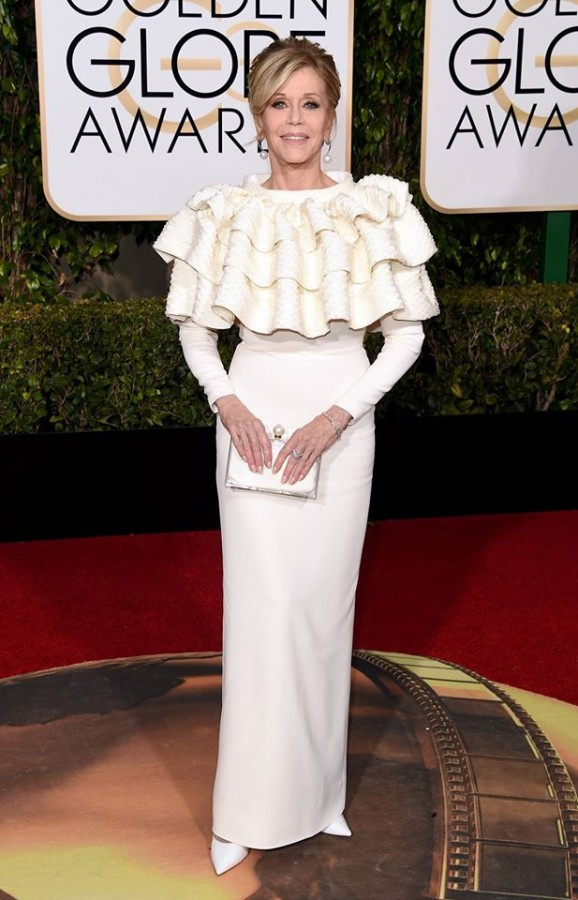 Jane Fonda wears a white frilled Yves Saint Laurent dress with long sleeves. The gown would be beautiful for a mother of the bride or groom. Image: Yves Saint Laurent via Facebook