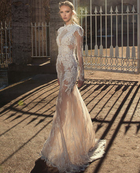Raw edged lace mixed with sheer layers of tulle are certainly the highlights of this Netta BenShabu wedding dress. Image: Netta BenShabu via Facebook