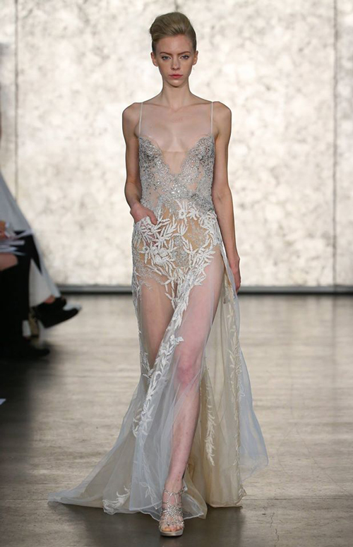 A see-through ethereal dress with silver tones and foliage-inspired embroidery. Image: Inbal Dror via Facebook