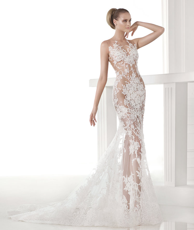 Carola from Pronovias Atelier is a Modern, tulle, mermaid dress with lace appliqué in all the right places.