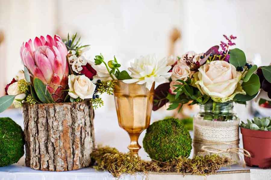 10 budget friendly centrepiece ideas easy weddings uk for Cool wedding table decorations
